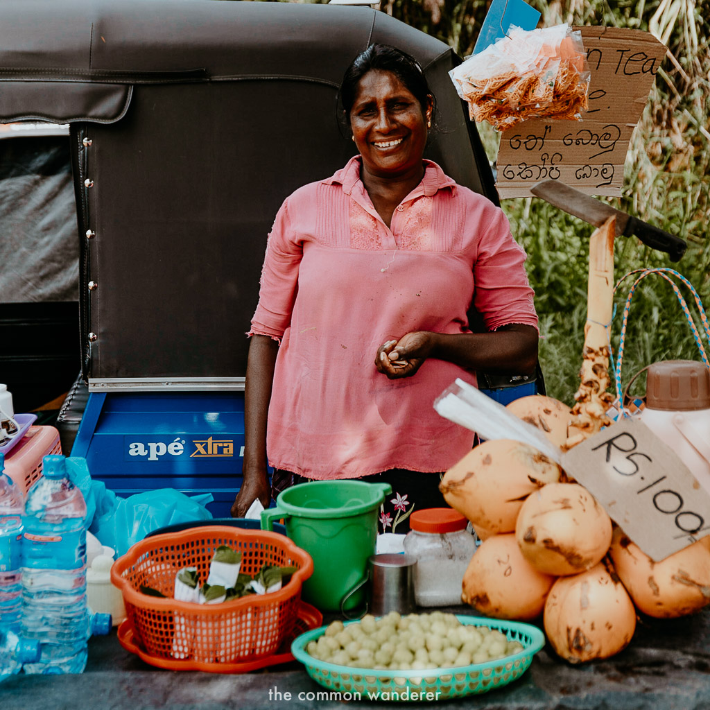 A women sells goods on the side of the road in Sri Lanka