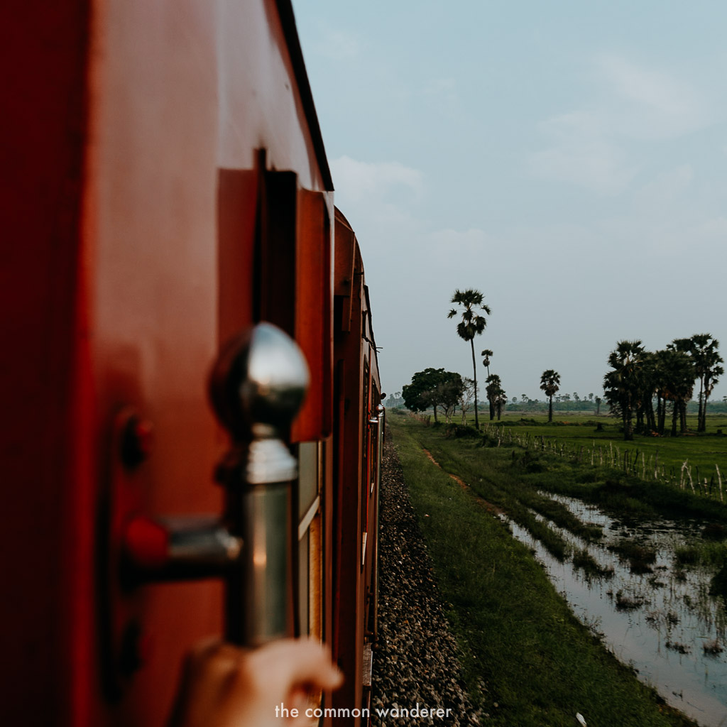Hanging out the train from Jaffna to Colombo, Sri Lanka