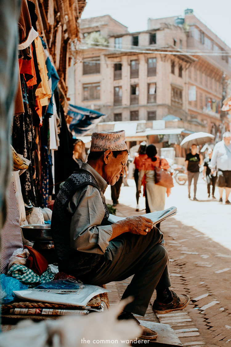 A man reads a newspaper in Bhaktapur old town, Kathmandu