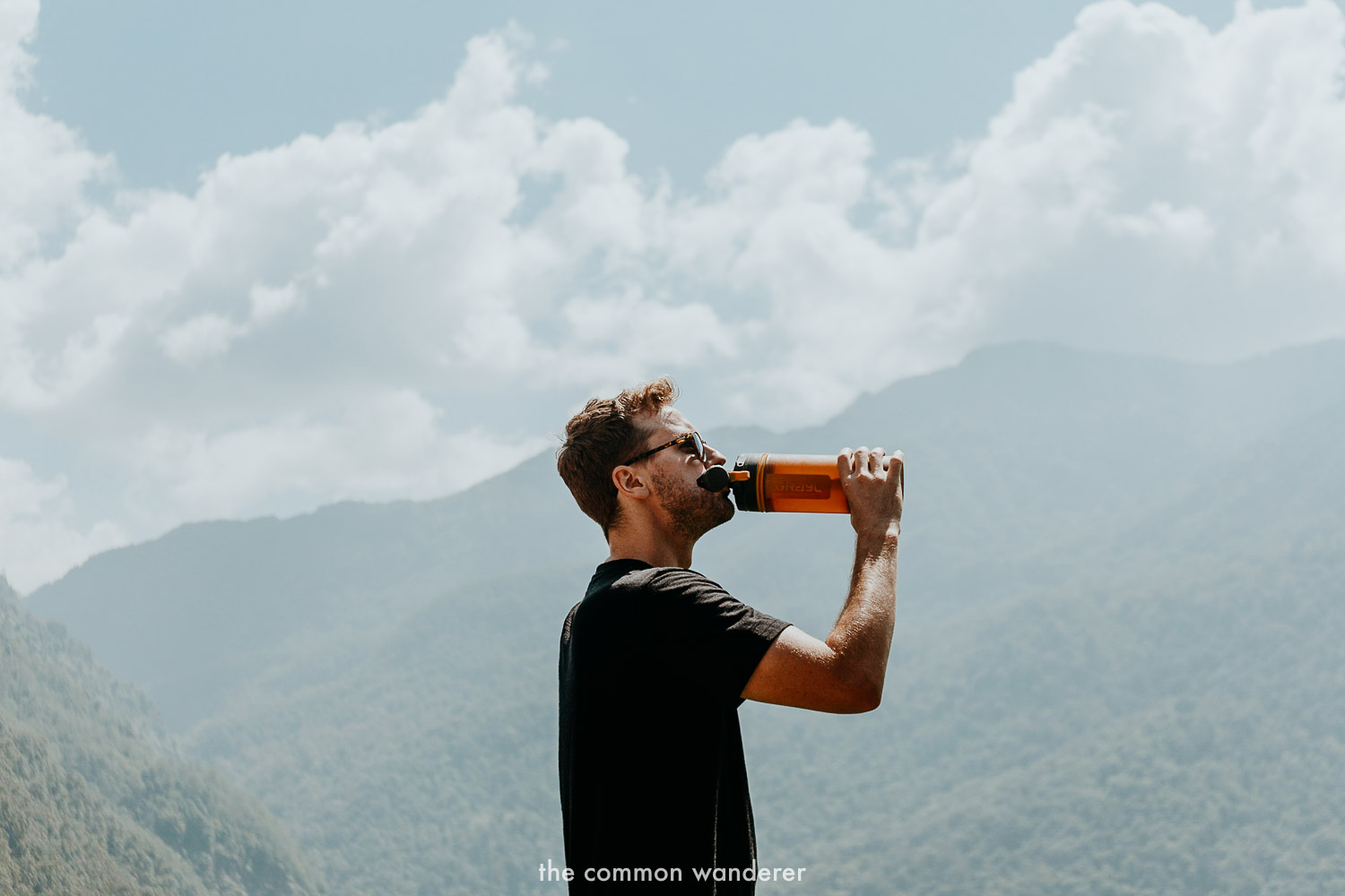 Using our Grayl drinking bottle while hiking the Ghorepani Poon Hill trek in Nepal