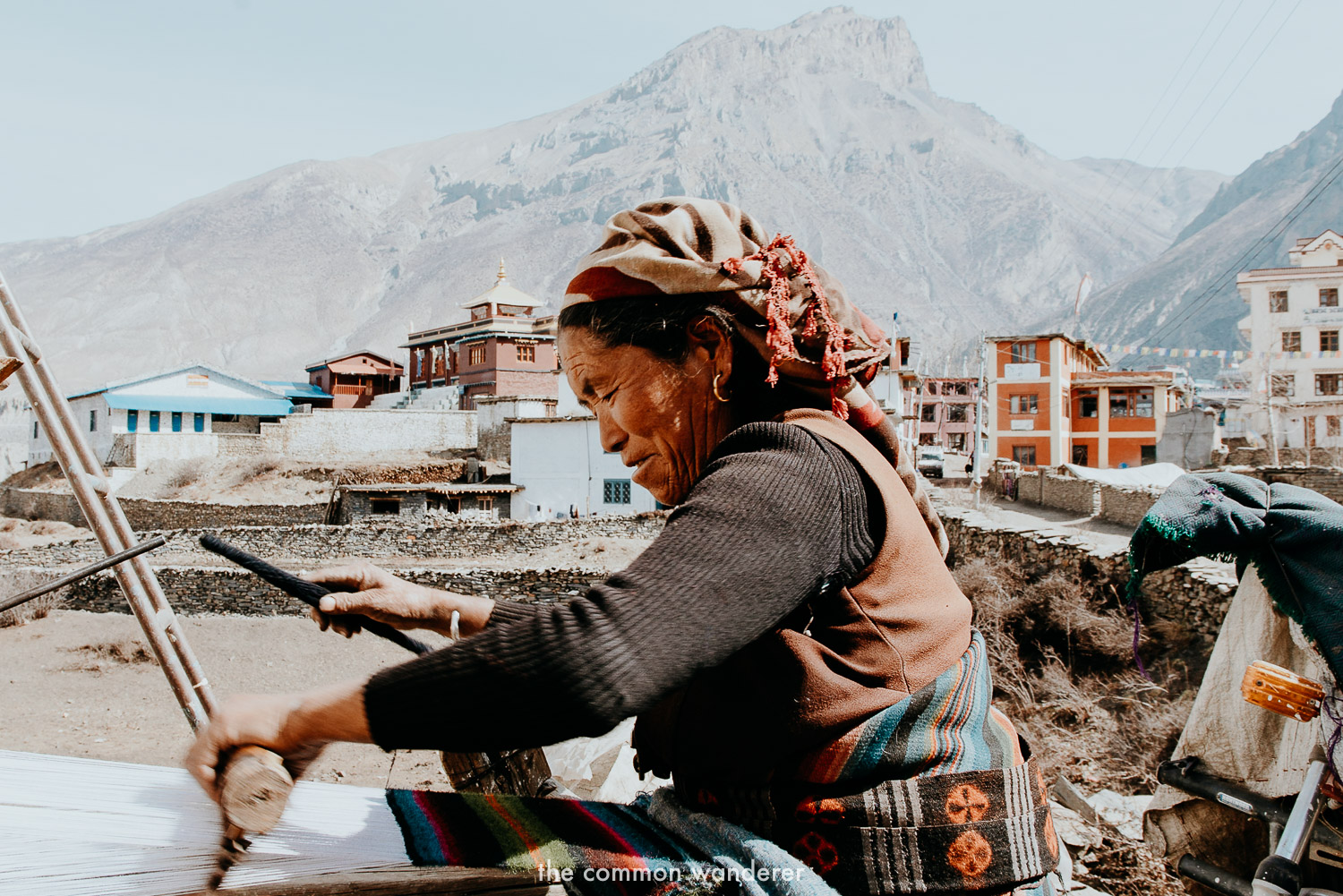 A local women makes a traditional scarf in Muktinath, Annapurna Circuit Nepal