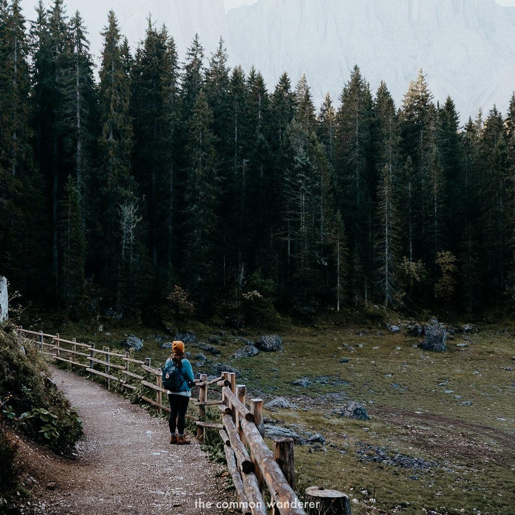 admiring the views while hiking around lago di Carezza