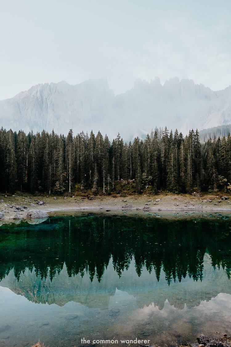 The emerald waters of Lago di Carezza during sunrise