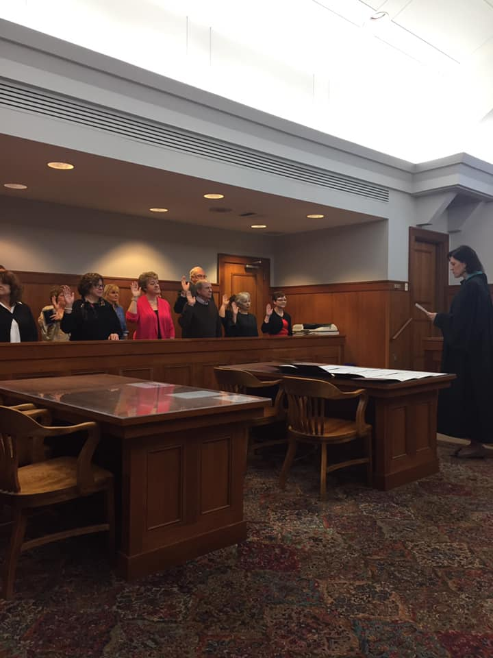 CASA's spring 2019 training class recites the Oath of Office, administered by Judge Jennifer Rogers.