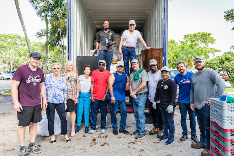 Members of the Seafarers International Union and Port Everglades staff take a break during the pick-up of items from Pier Sixty-Six Hotel