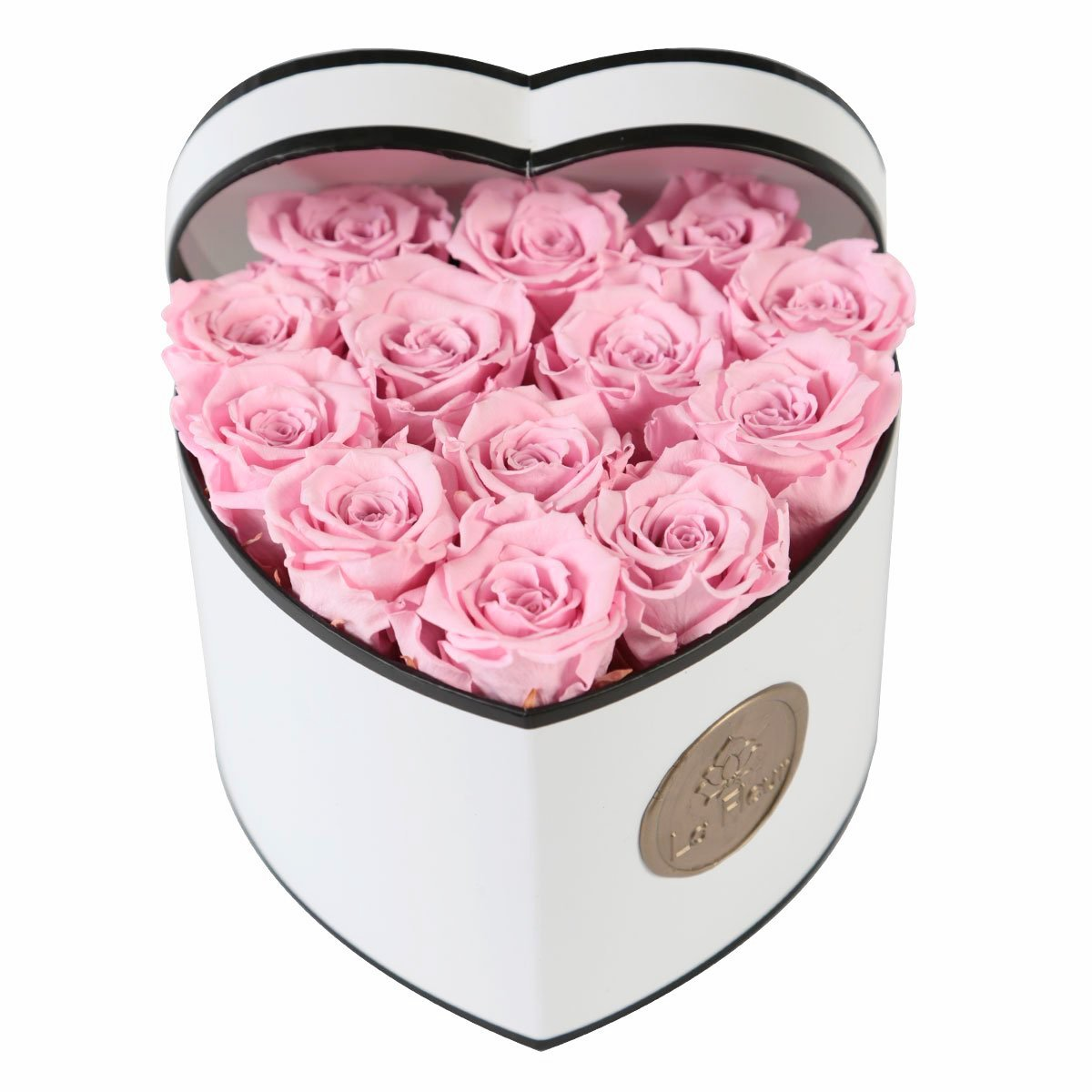 La Fleur Petite Heart - I said we wouldn't talk about roses. However, this gorgeous arrangement lasts an entire year! Available in multiple designs, colors, and boxes this arrangement is the perfect gift so you won't have to buy more flowers until next Valentine's Day.