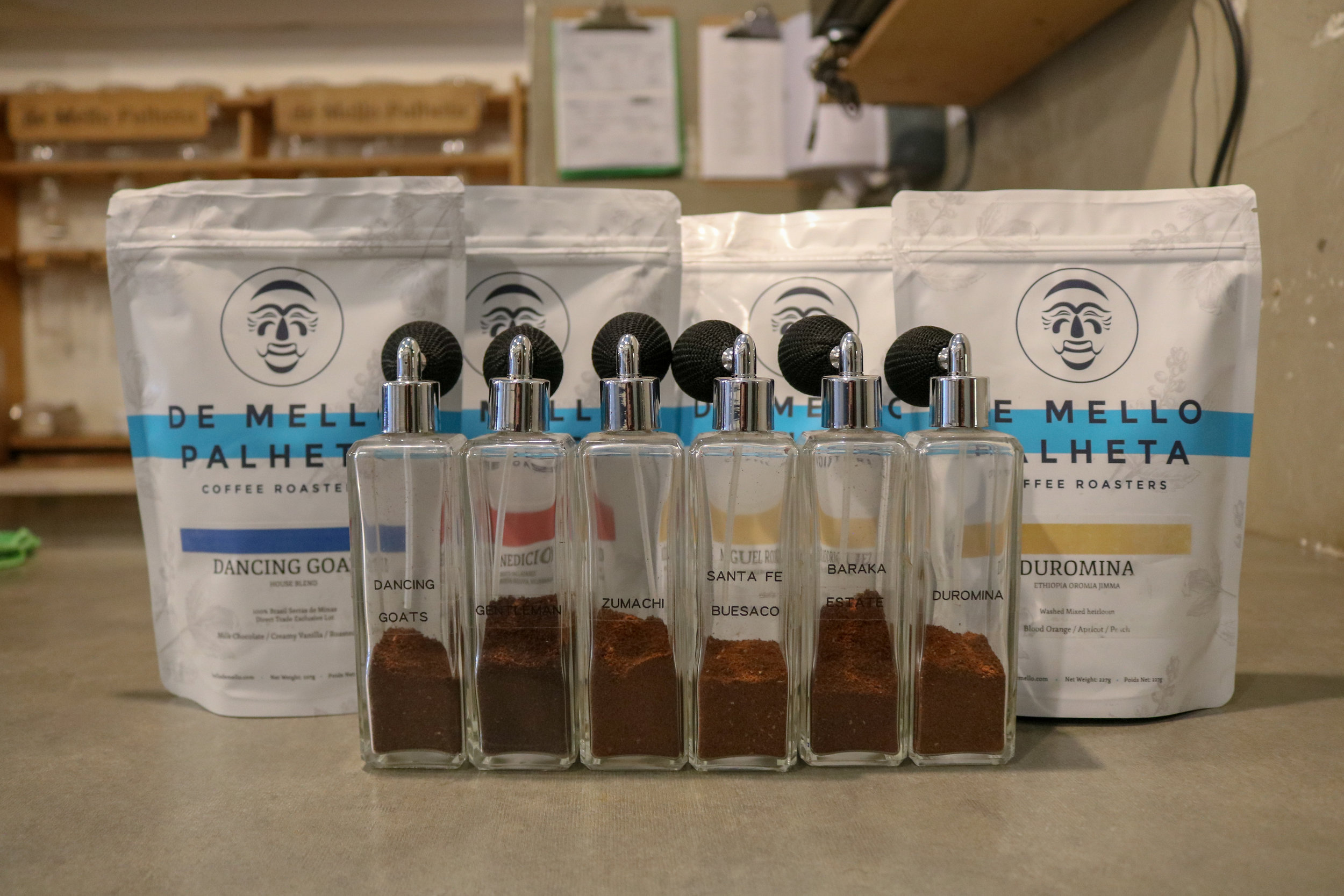 Coffee in perfume bottles and and de mello coffee bags