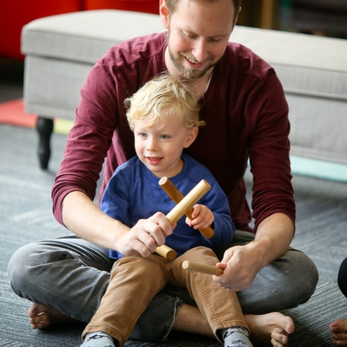 Kindermusik-2017_dad_playing_rhythm_sticks_with_son-1024x683.jpg