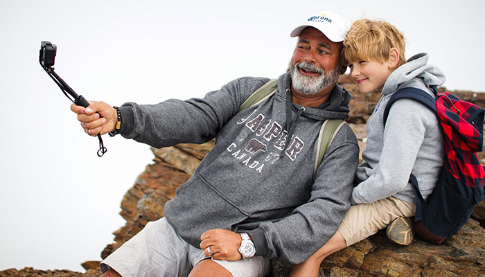 a-grandfather-and-grandson-posing-for-an-epic-selfie-on-a-mountain-summit_t20_EngE0V.jpg