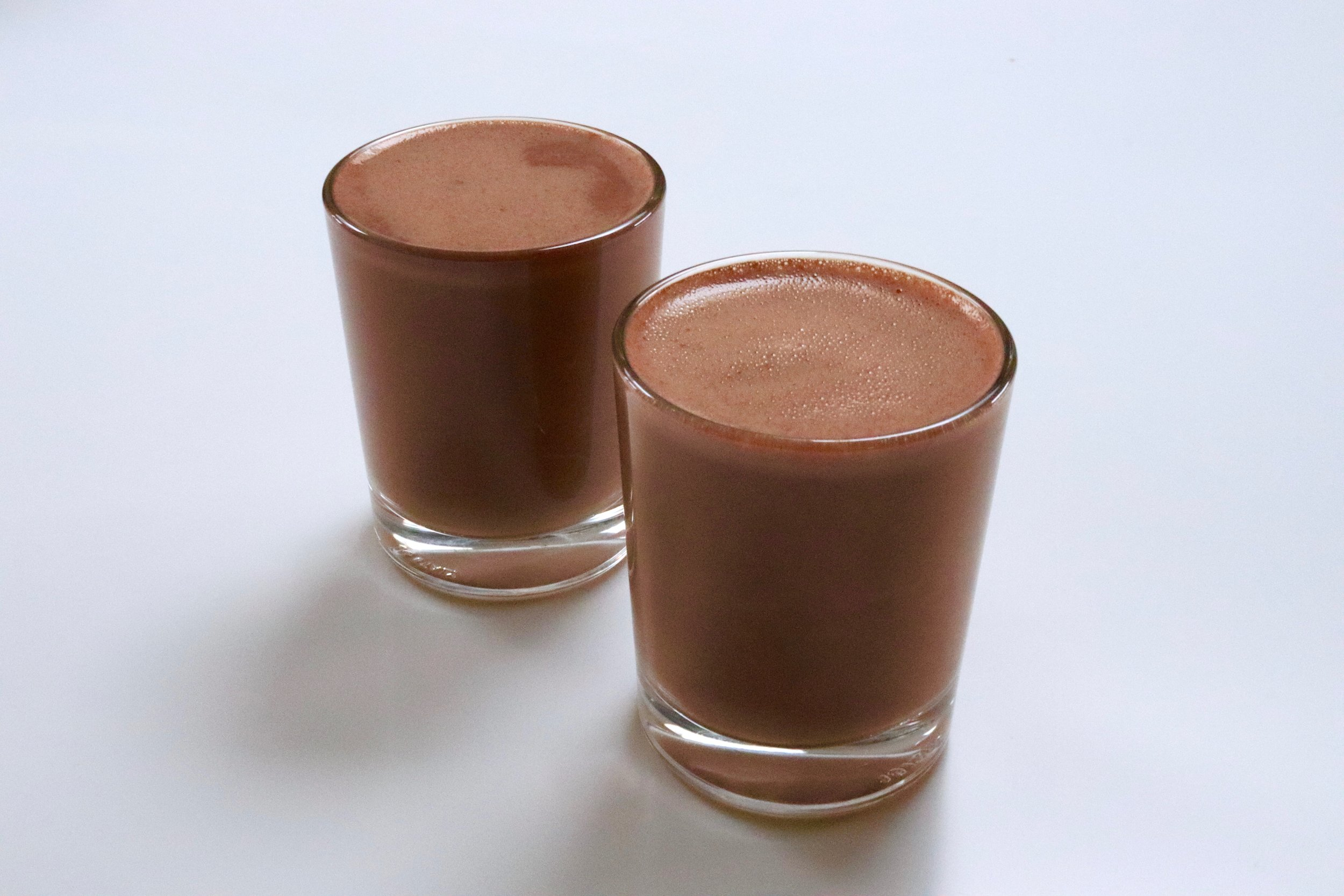 Generous, indulgent and naturally sweetened hot chocolate shots made from raw cacao beans