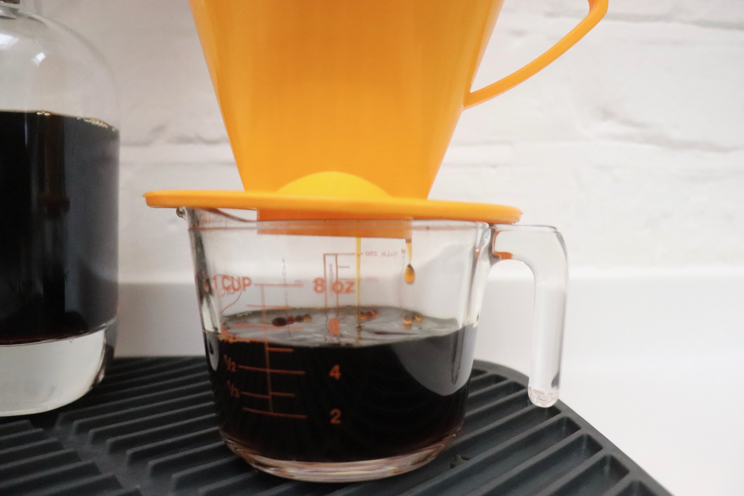 Pass the coffee concentrate through a coffee filter
