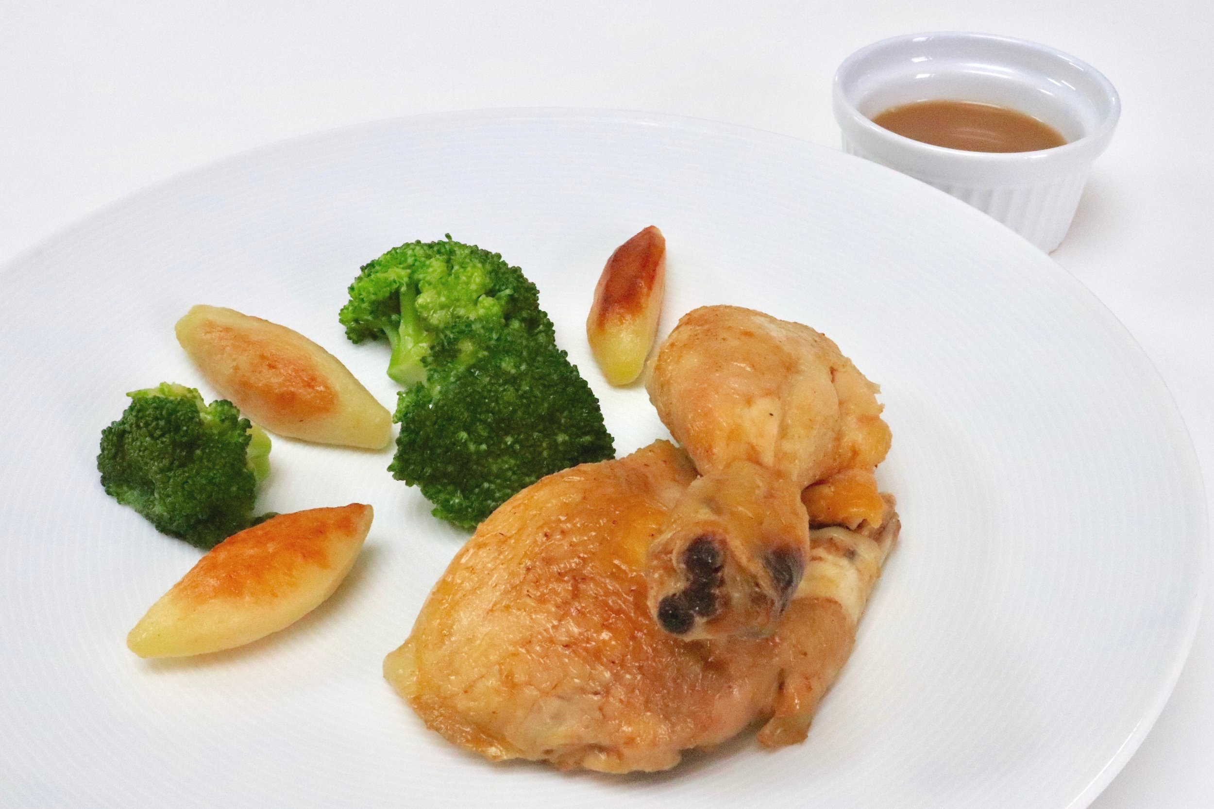 Roast chicken, turned potatoes, broccoli and jus