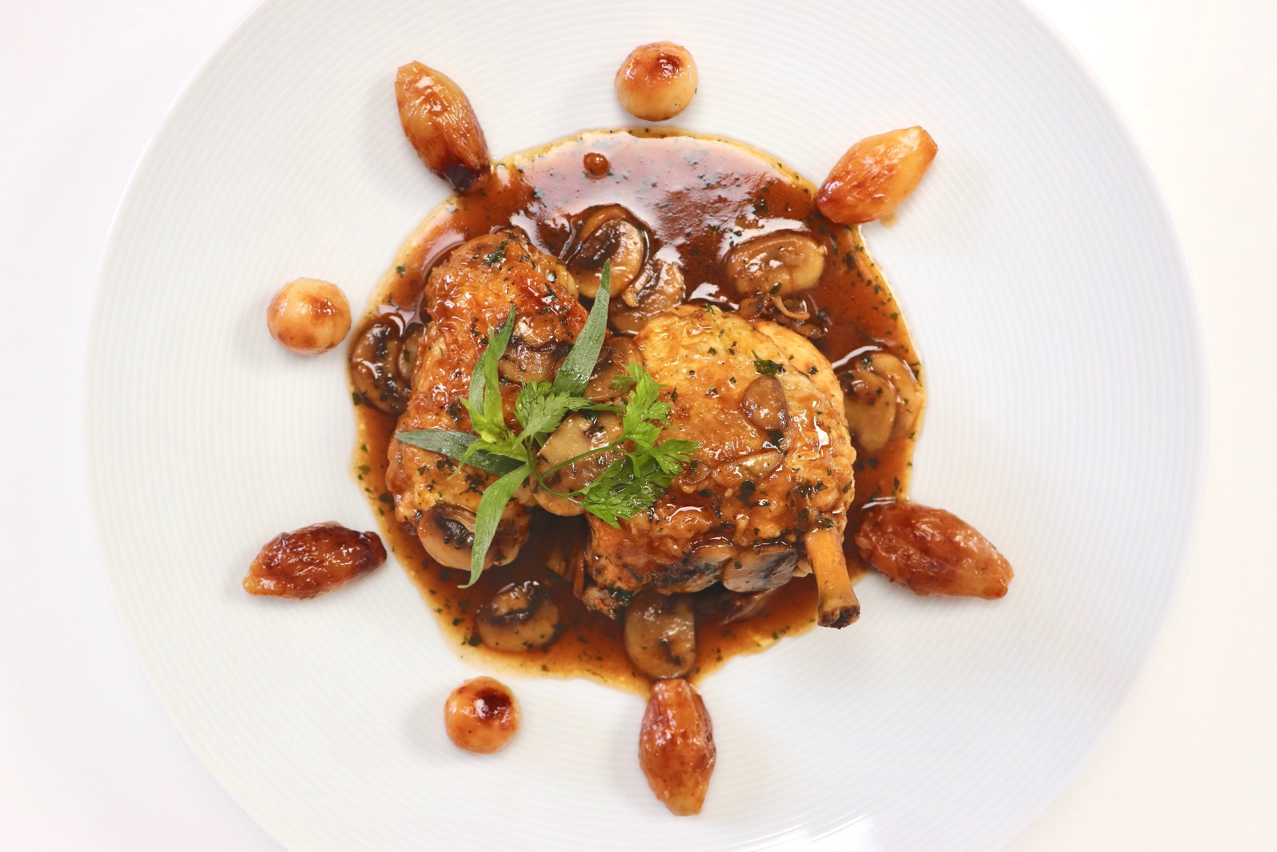 Pan-fried chicken in mushroom, chervil and tarragon sauce