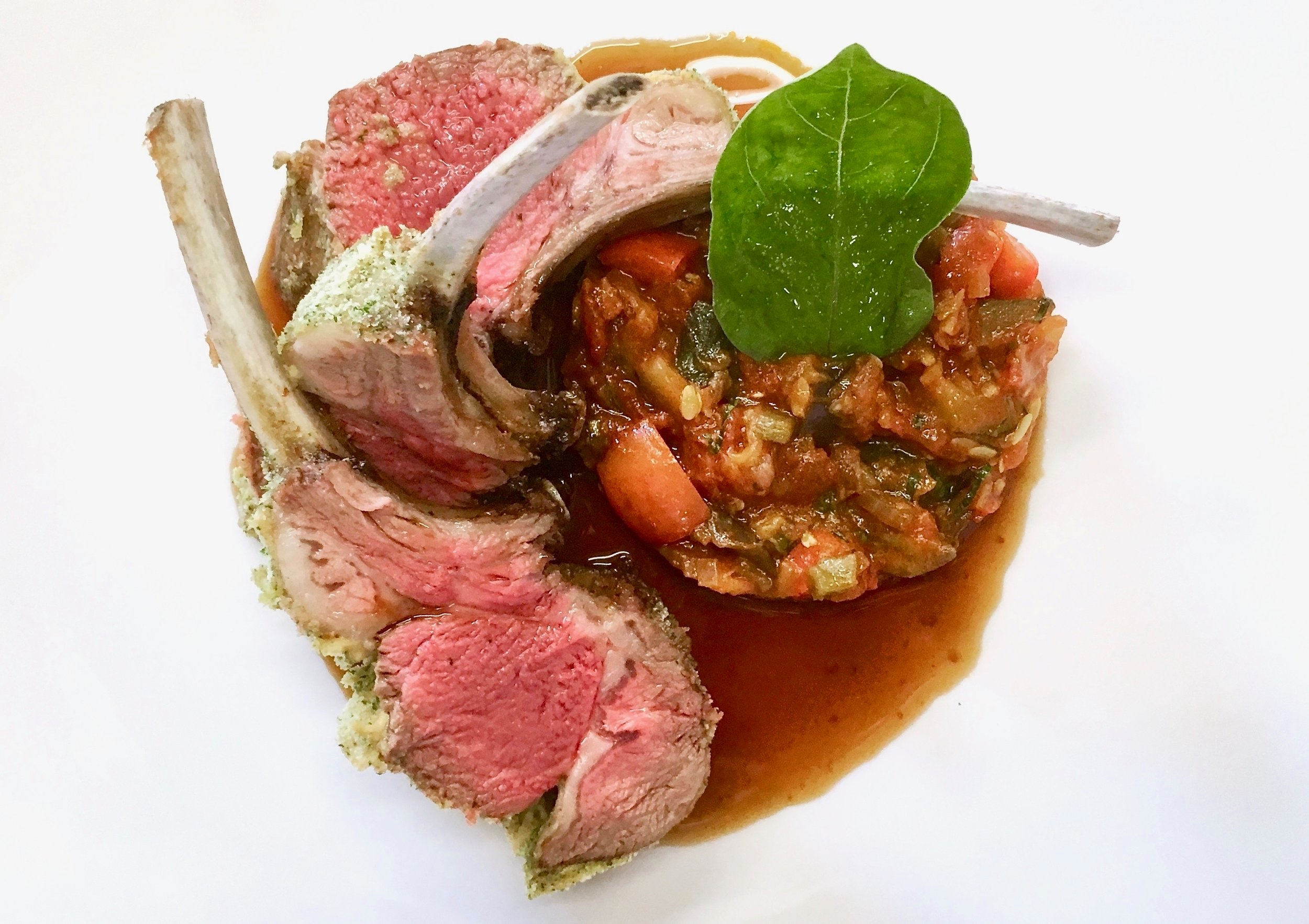 Rack of lamb with a parsley crust, ratatouille and lamb jus