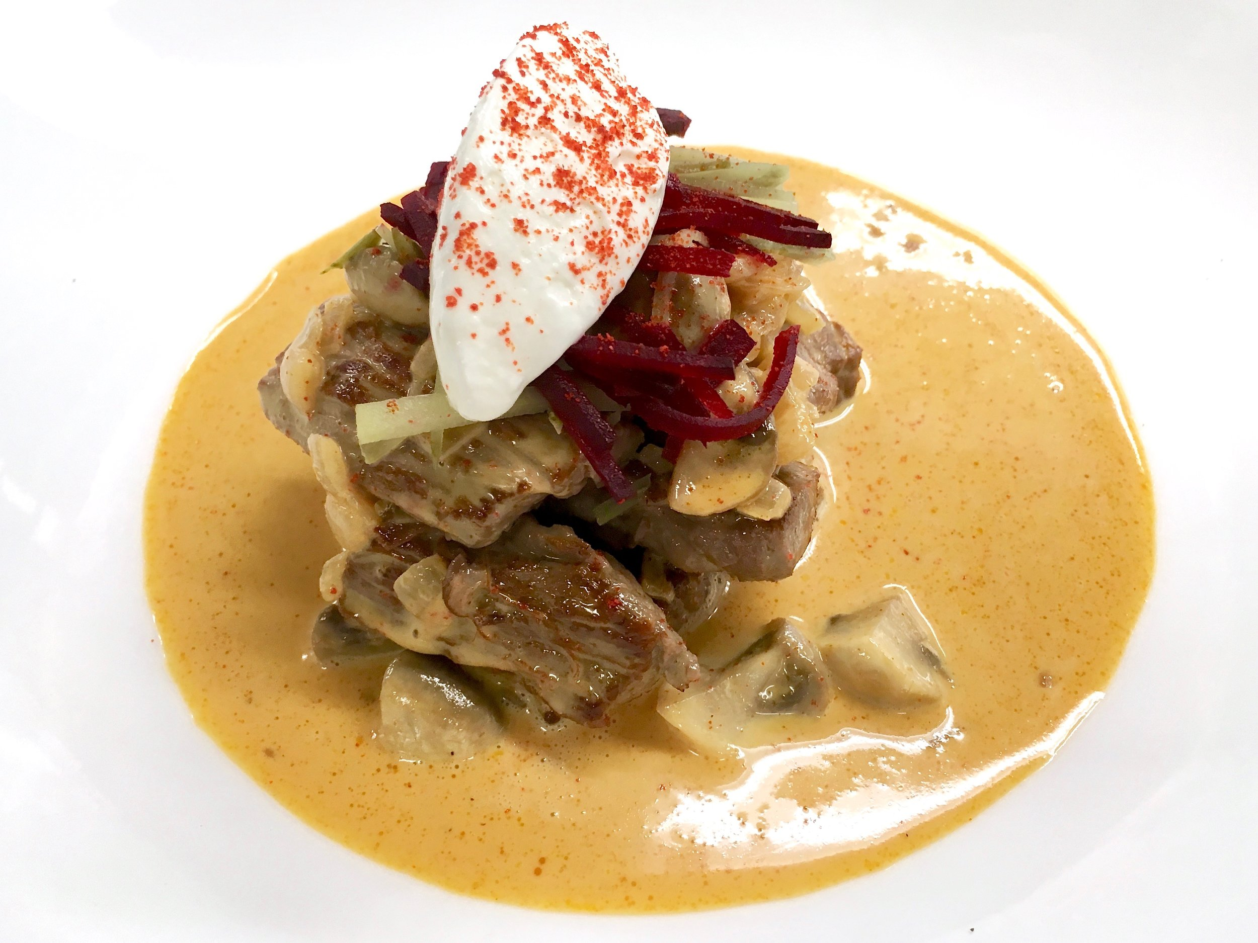 Beef stroganoff with beetroot and cornichon