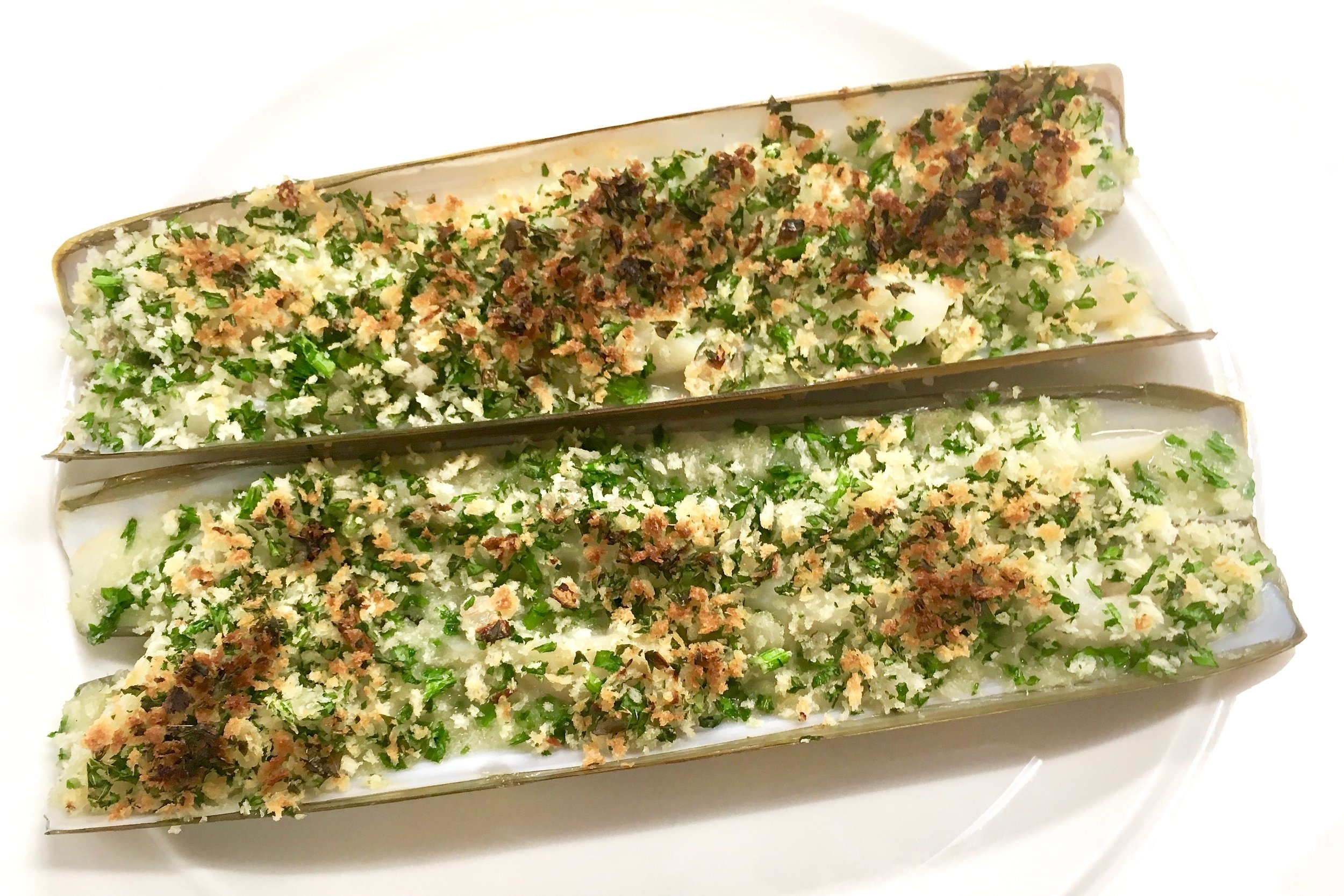 Razor clams served in their shells with a parley crust
