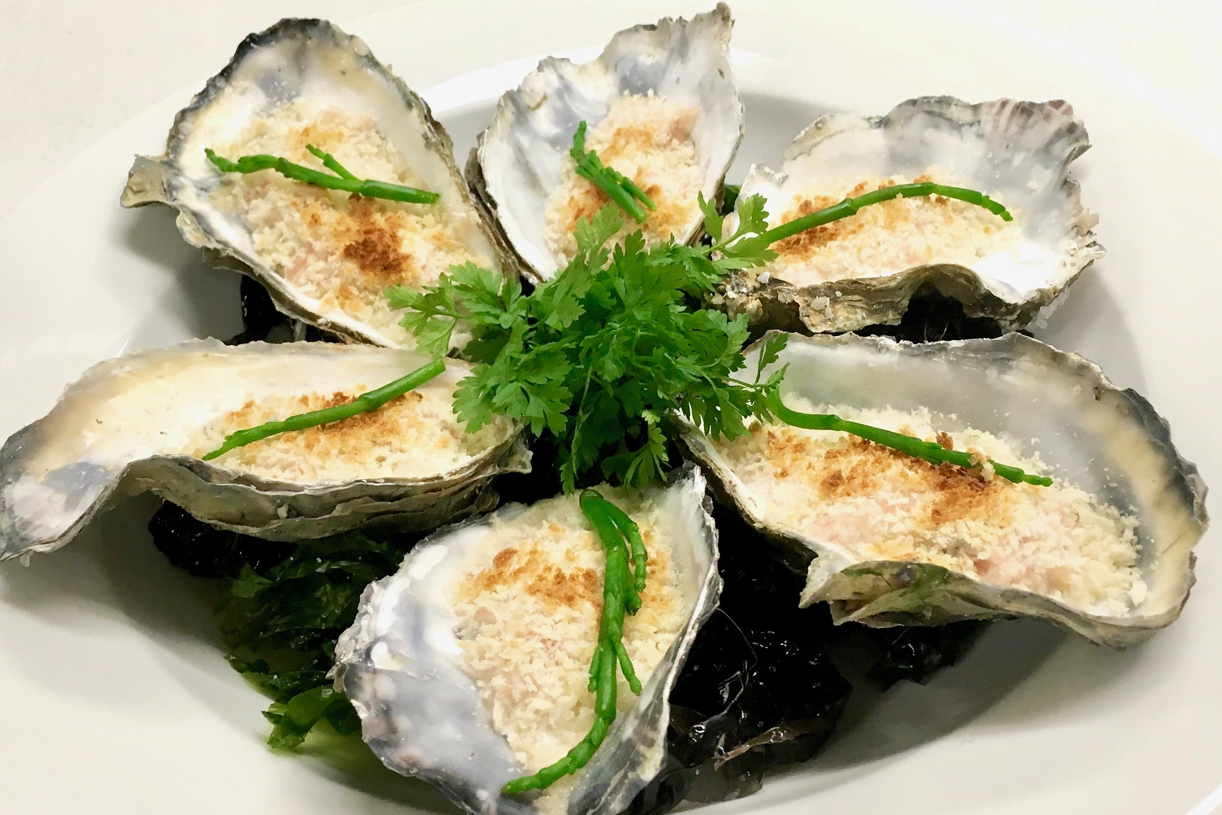 Warm Brittany-style oysters