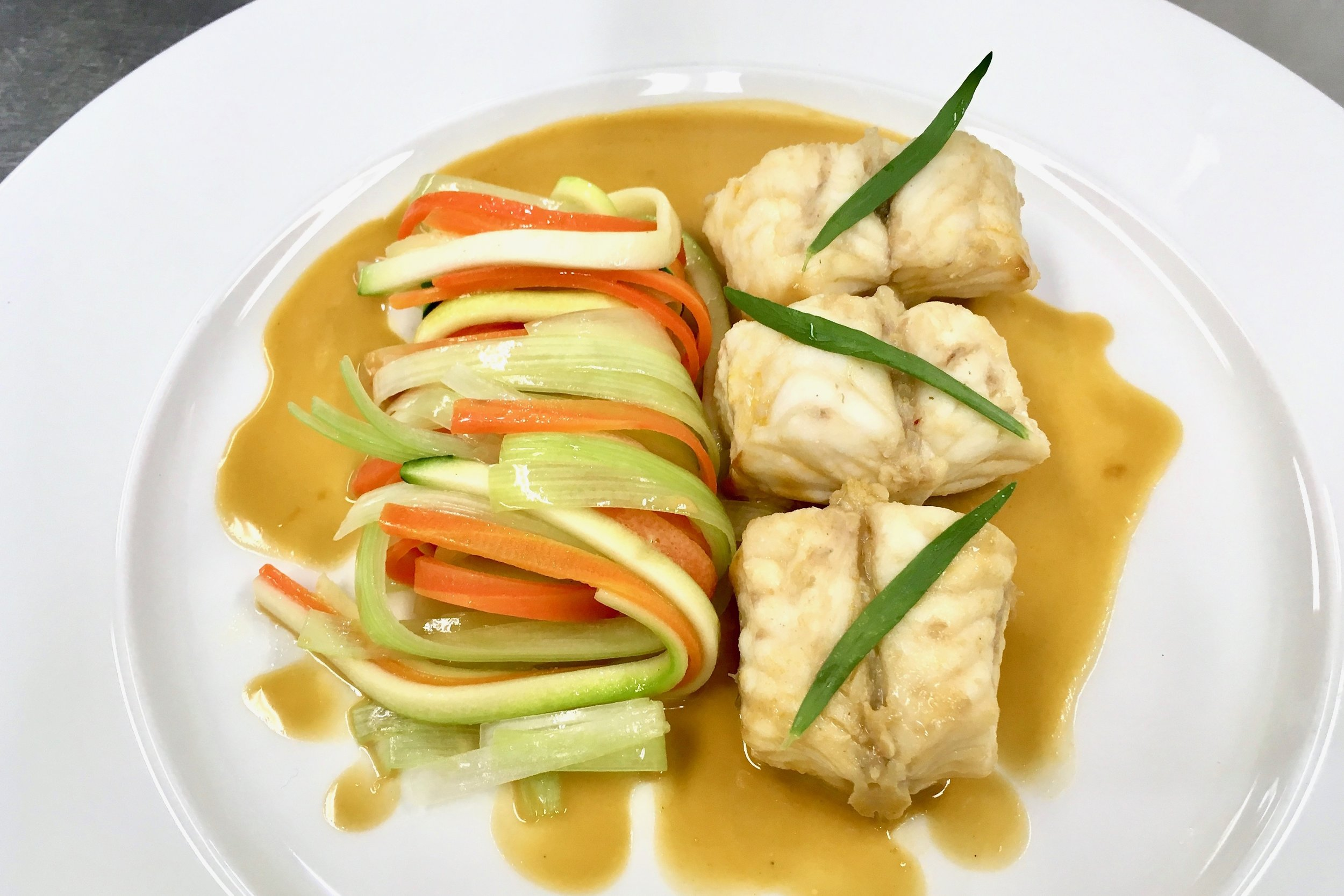 Poached monkfish in a shellfish sauce