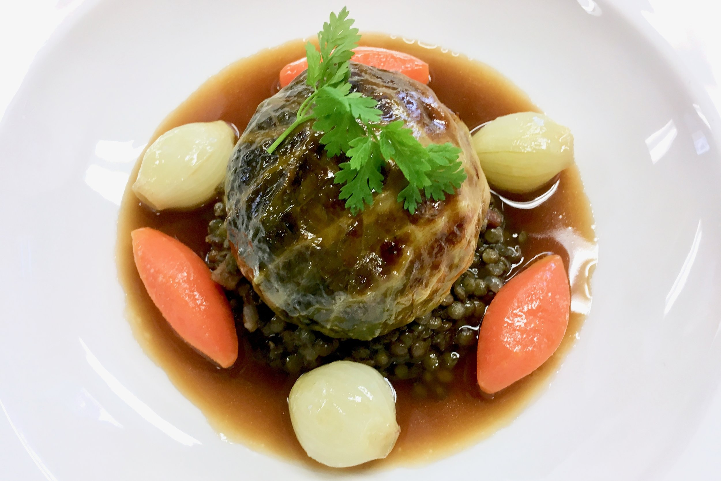 Chef's stuffed cabbage and lentil stew