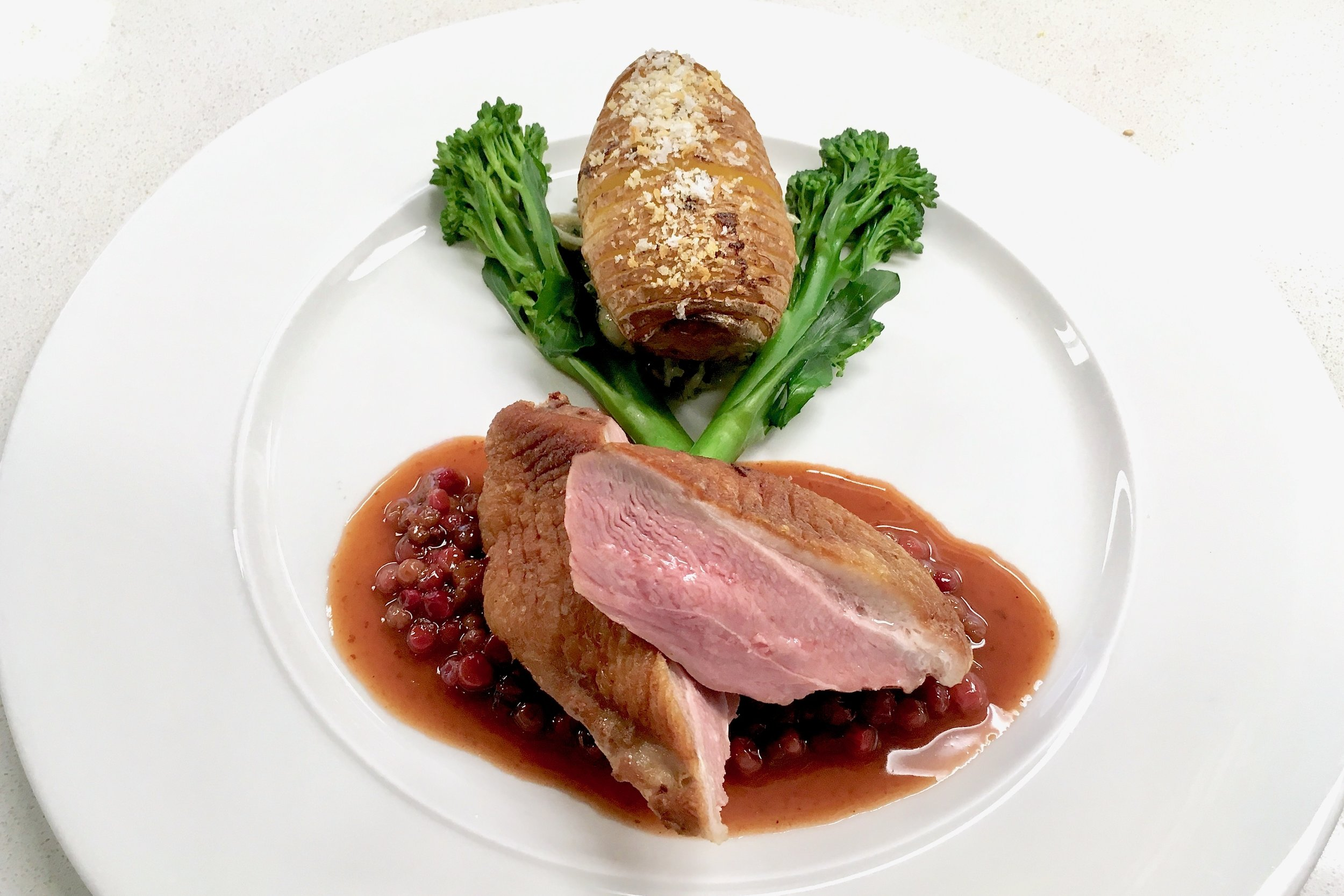 Pan-fried duck breast with lingonberries and wild mushrooms