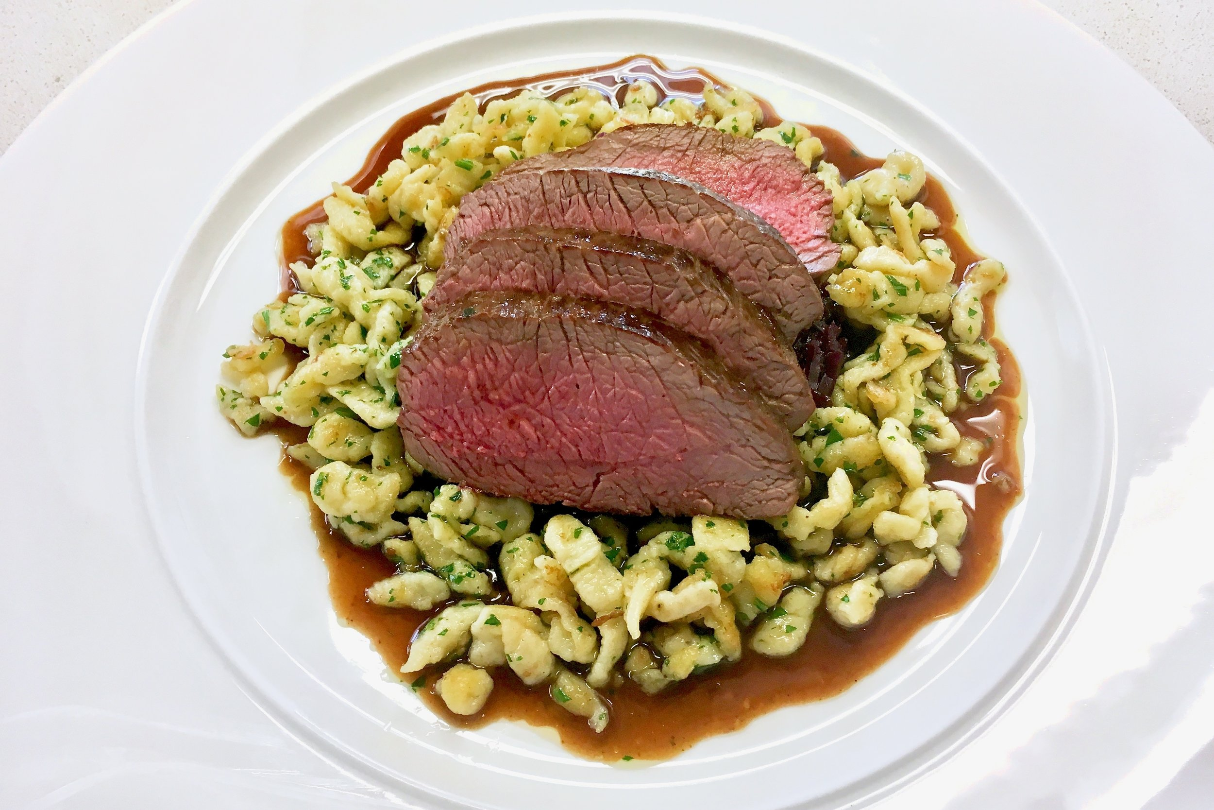Venison loin with spätzle and red cabbage