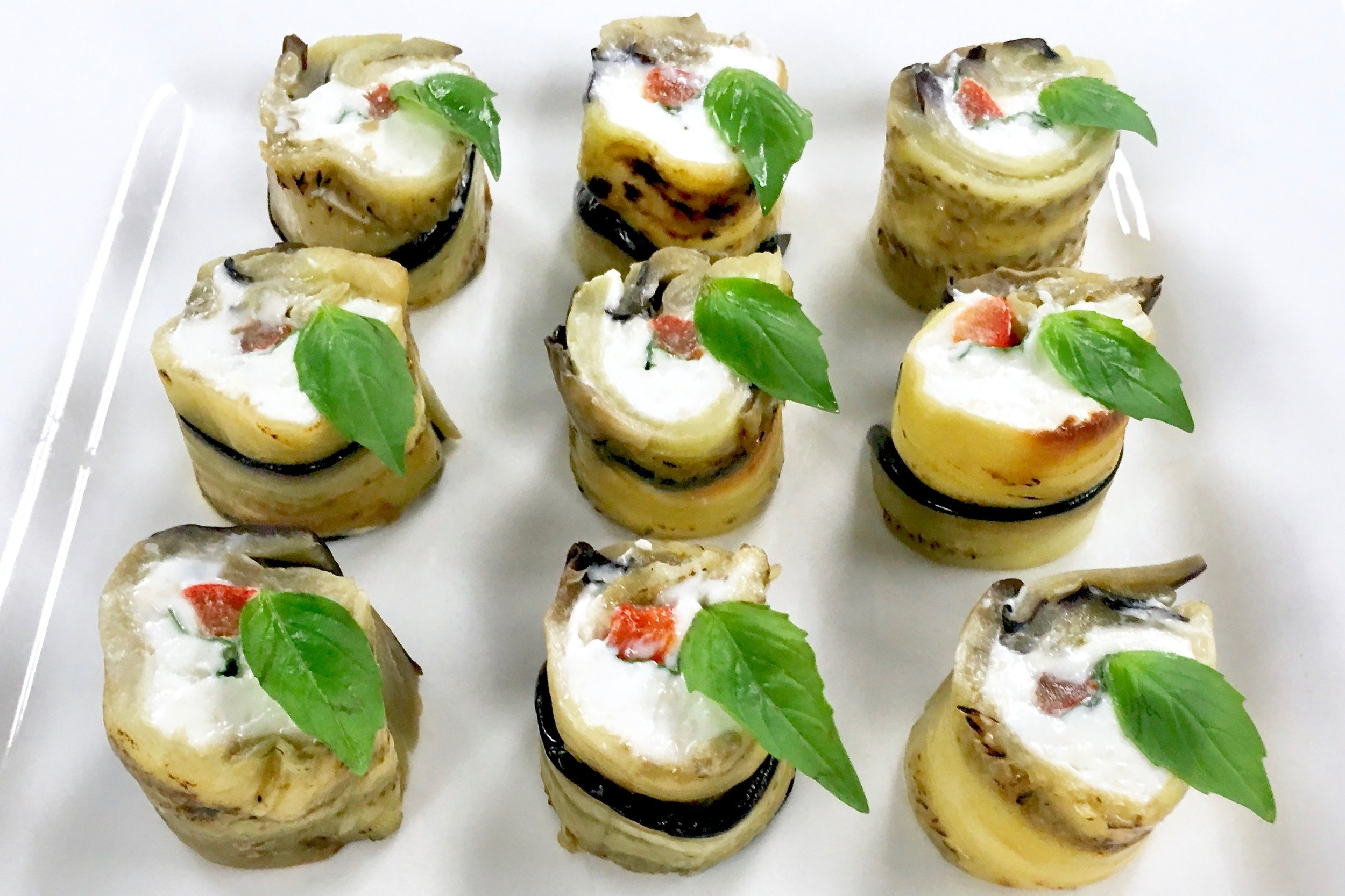 Aubergine rolls with goats cheese, basil and confit red pepper