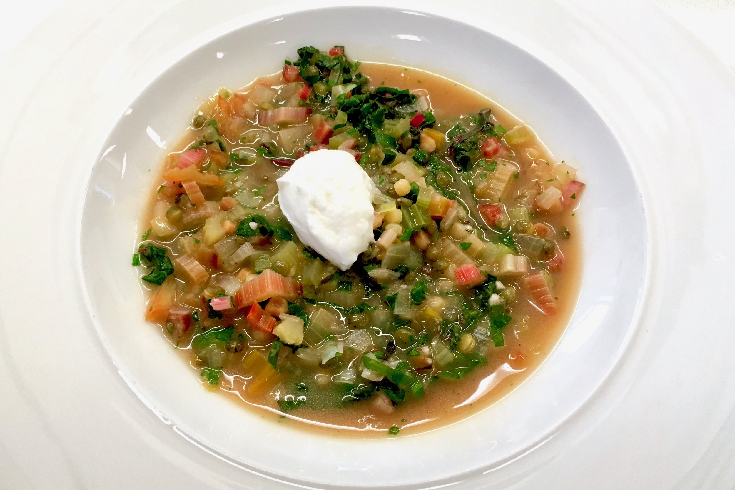 Rainbow chard and lentil soup with fregola and goats curd