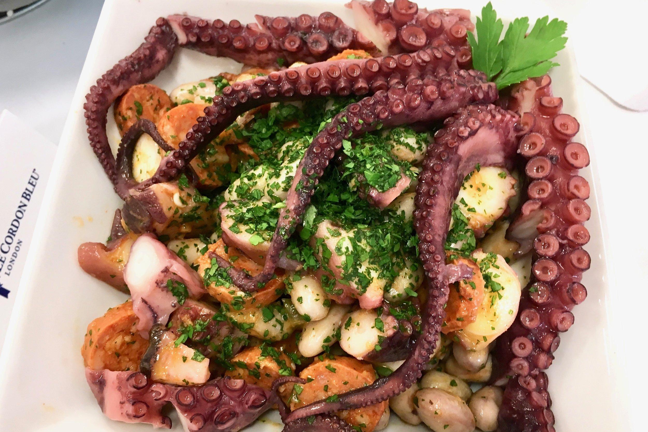 Braised octopus with chorizo, borlotti beans and garlic sauce