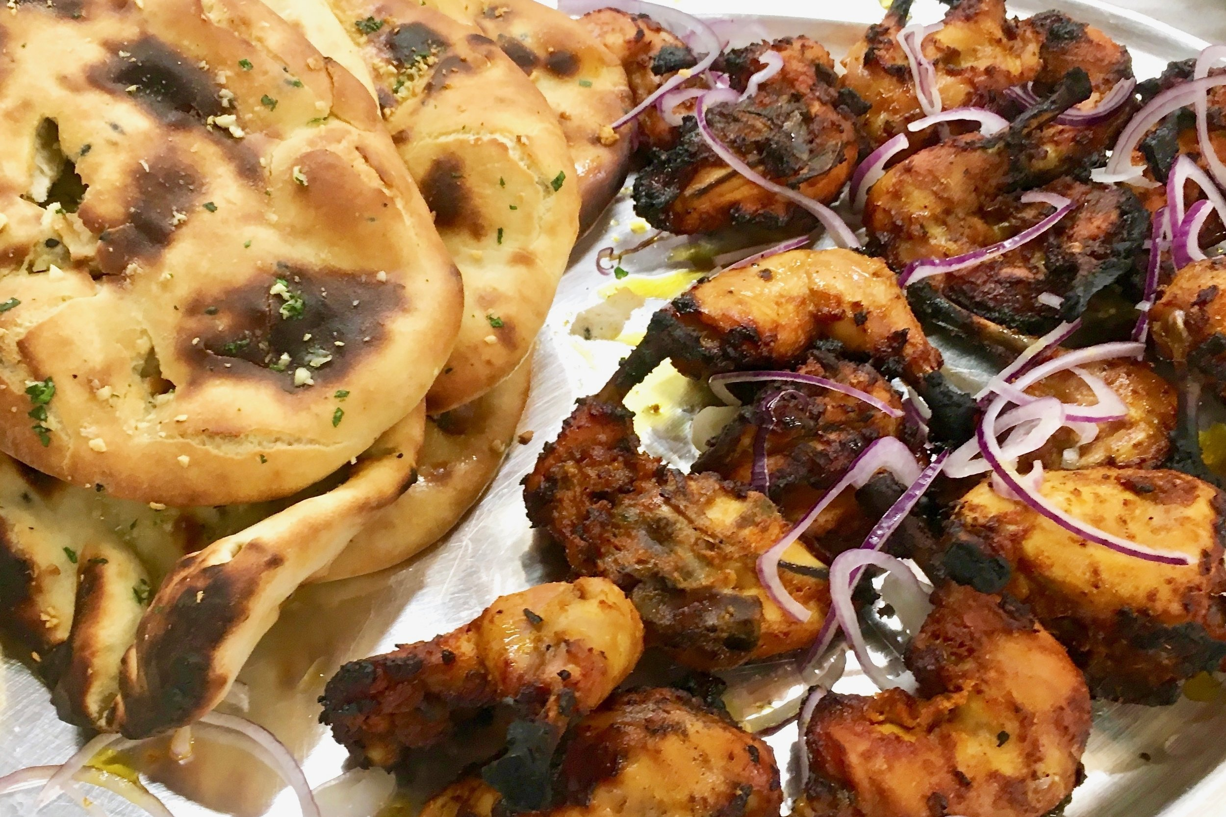 Tandoori chicken with naan bread