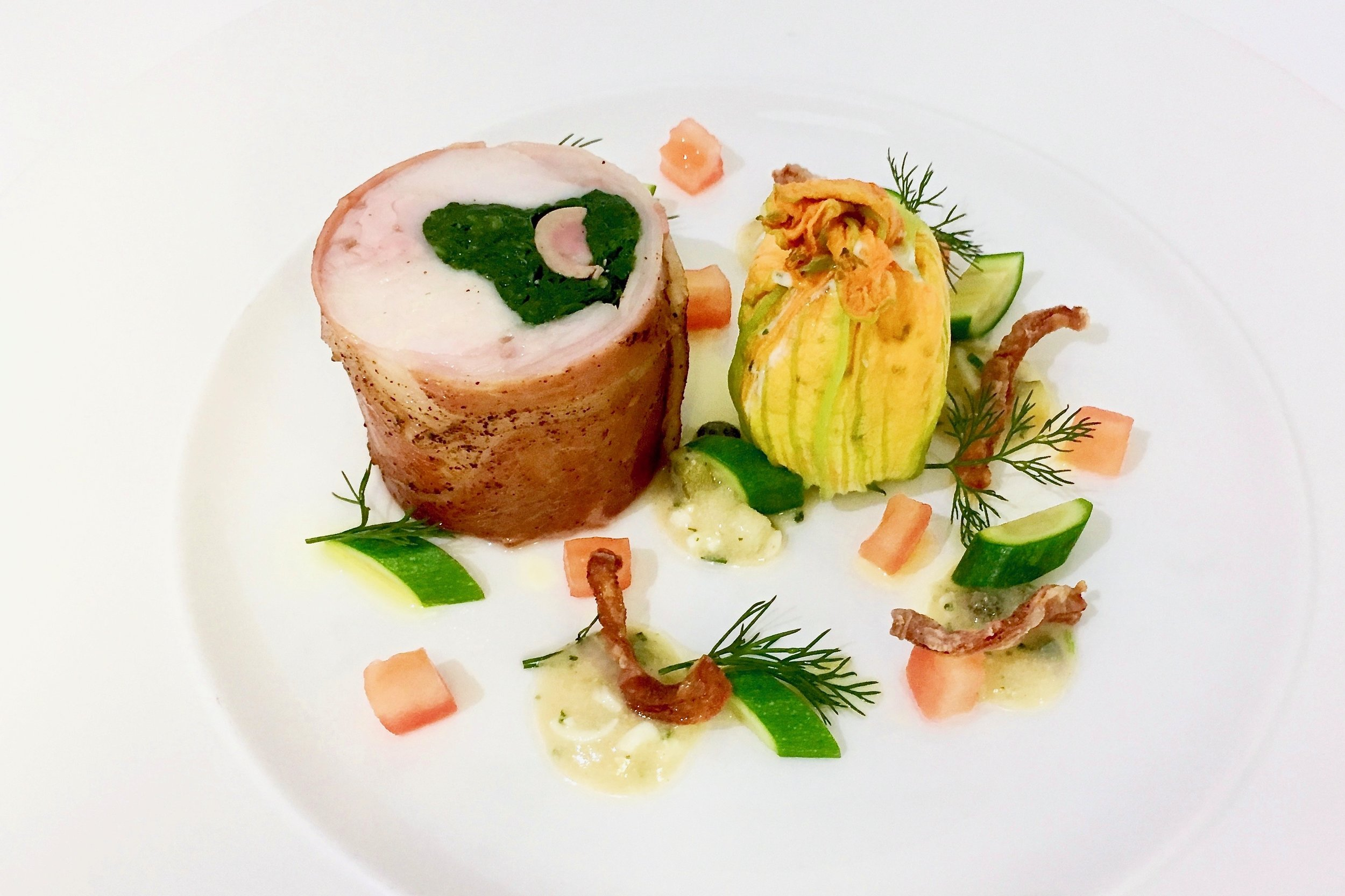 Stuffed saddle of rabbit with crispy belly, courgette flower with chicken mousse and ravigote sauce