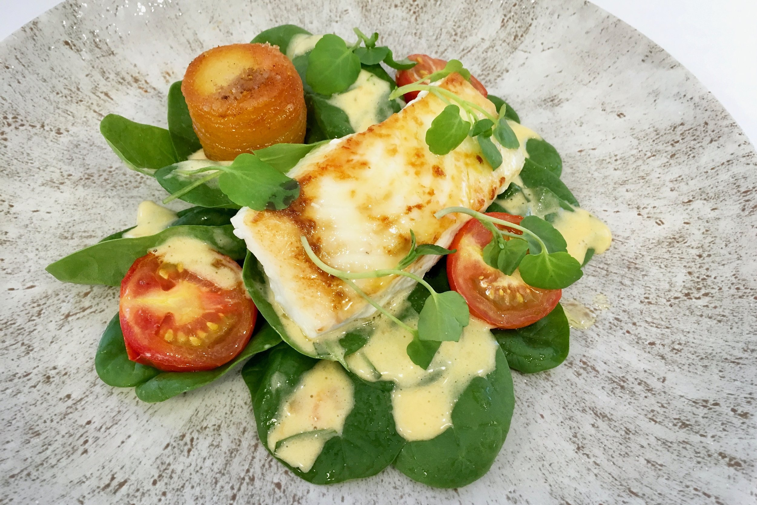 Halibut steak with Pommes Anna and Choron sauce