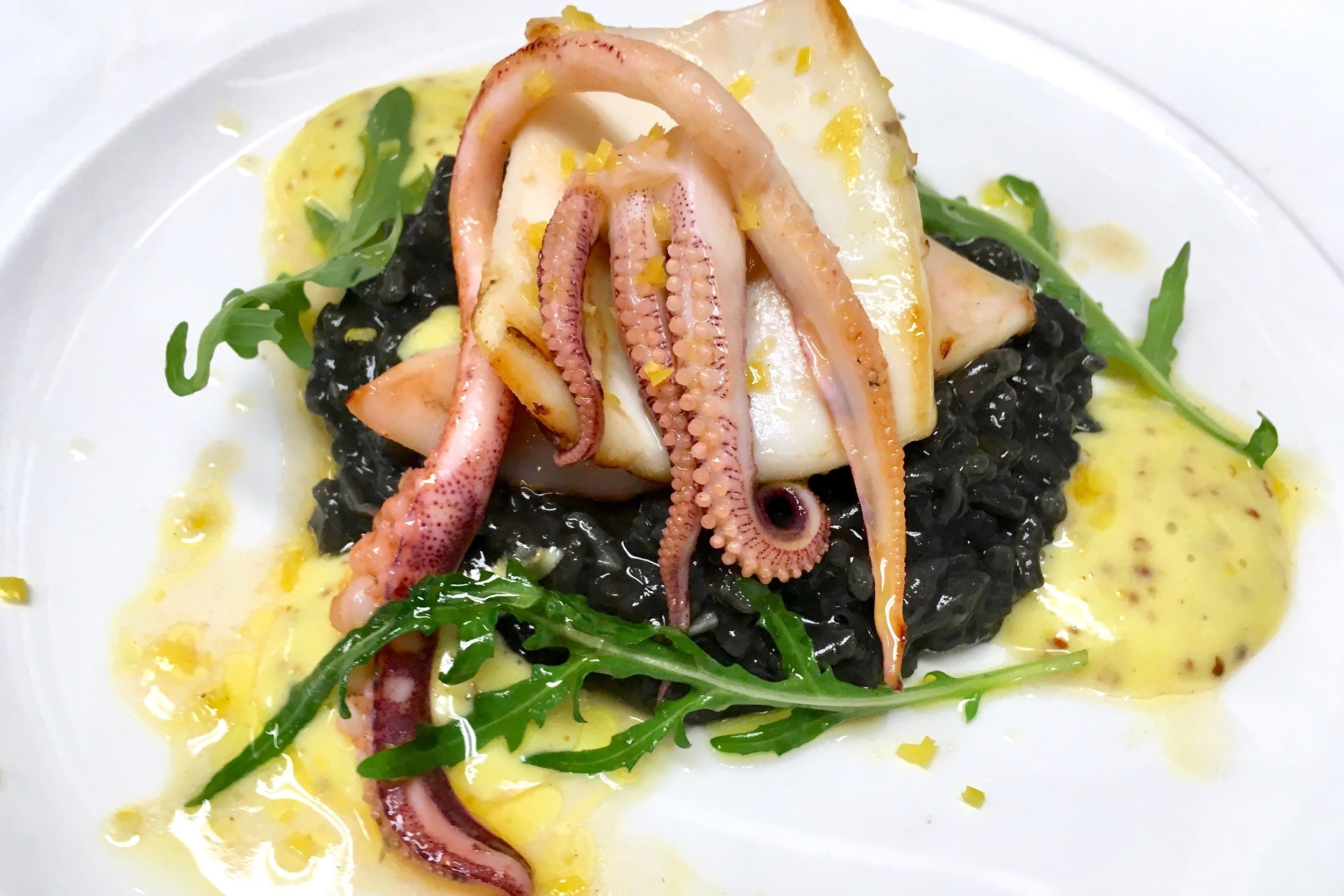 Squid ink risotto with marinated squid and a mustard emulsion