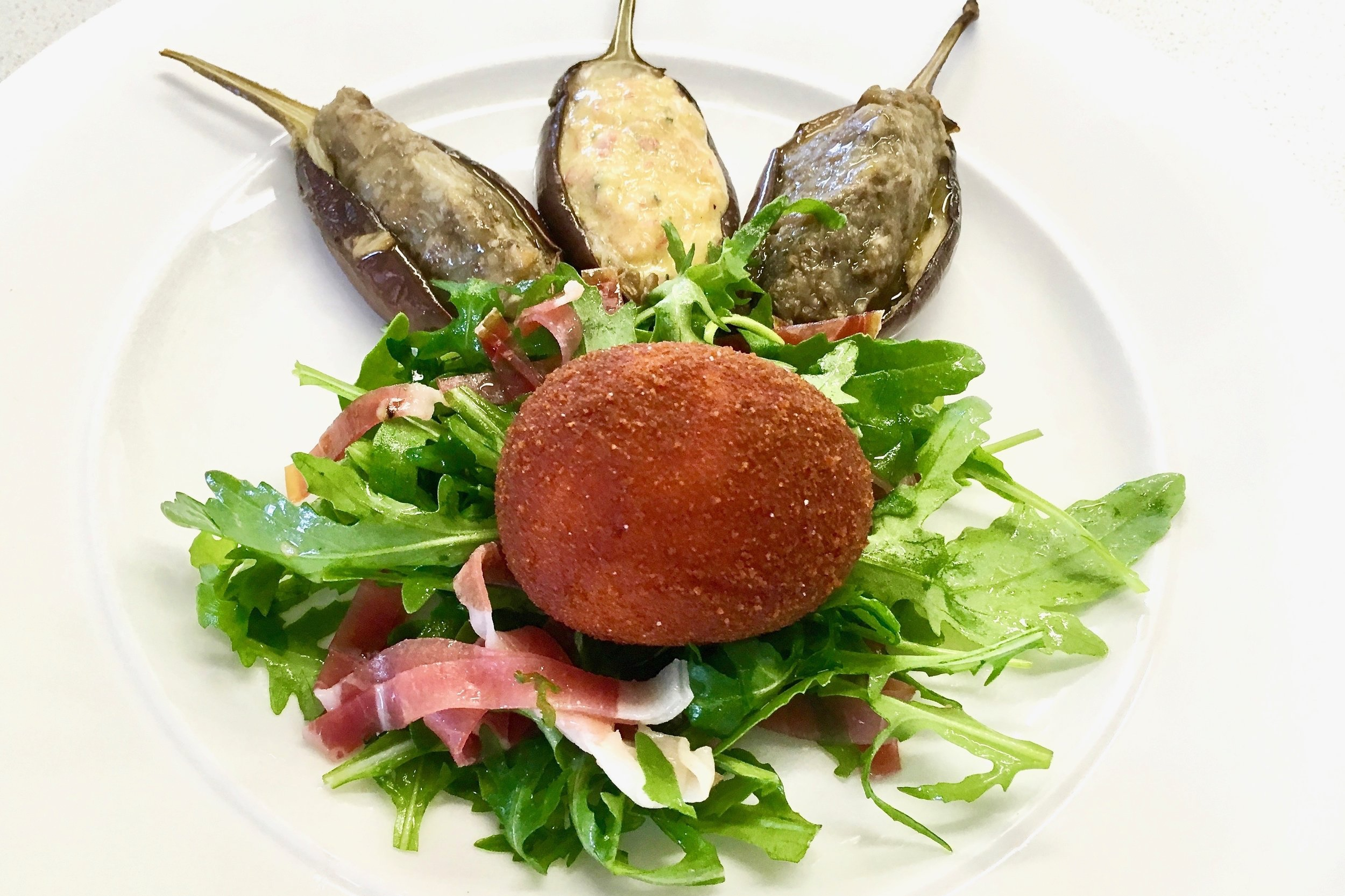 Egg in spiced breadcrumbs with a Bayonne ham salad in a red wine and shallot vinaigrette