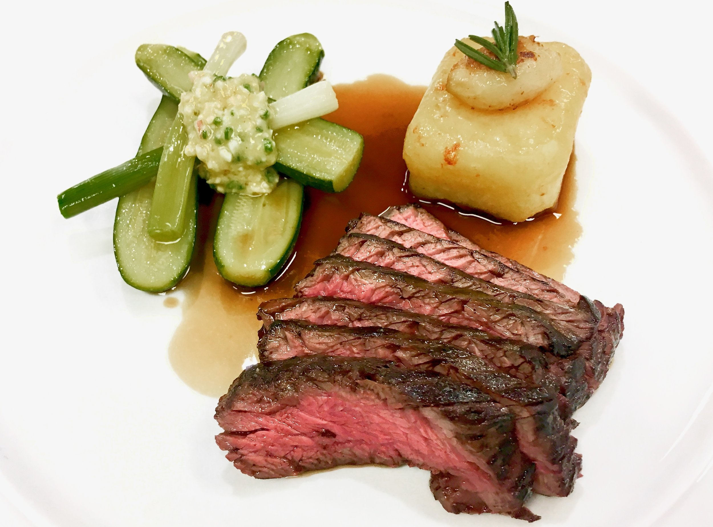 Beef Onglet and potato fondant with an egg and chive vinaigrette
