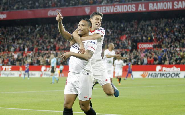 Luis Muriel and Jesus Navas celebrate a goal for Sevilla in La Liga