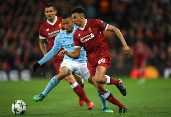 Trent Alexander Arnold dribbles away from Manchester City forward Gabriel Jesus