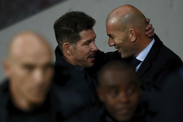 Atletico Madrid coach Diego Simeone embraces Real Madrid coach Zidane ahead of their La Liga fixture.