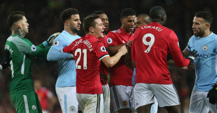 Romelu Lukaku and Marcus Rashford pf Manchester United battle with Otamendi, Kyle Walker and Fernandinho of Manchester City in the English Premier League