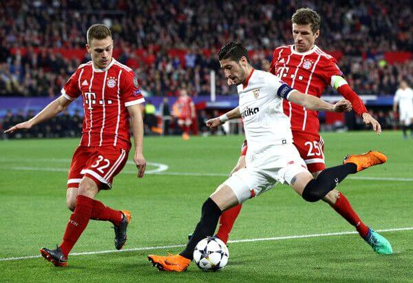 Kimmich and Thomas Muller battle against Sevilla in the UEFA Champions League