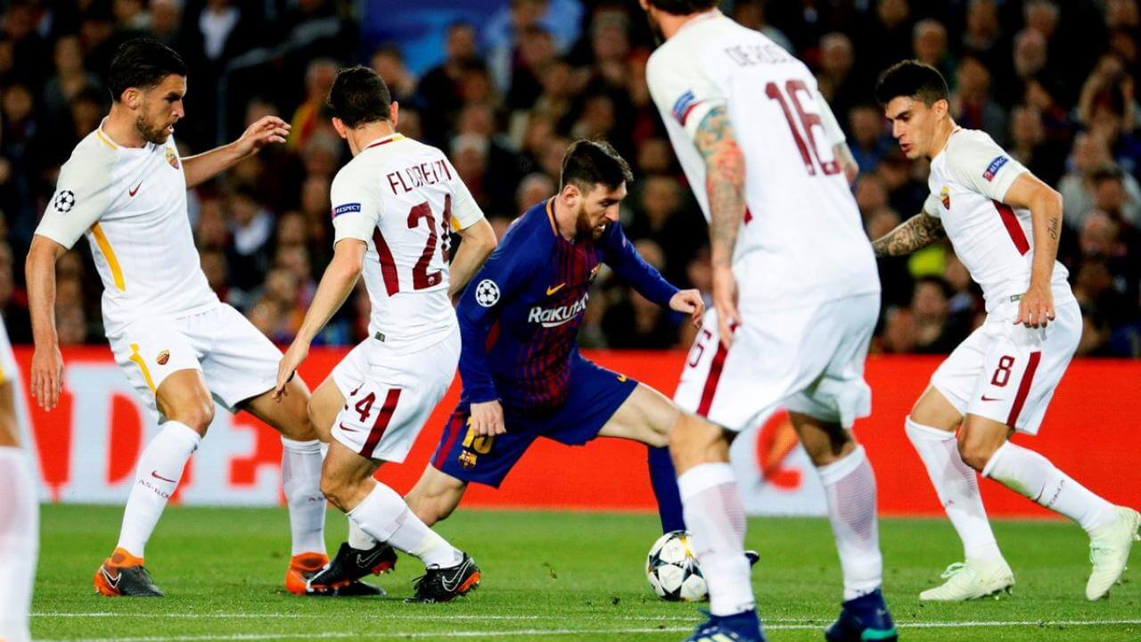 Lionel Messi dribbles through the AS Roma team for FC Barcelona in the UEFA Champions League
