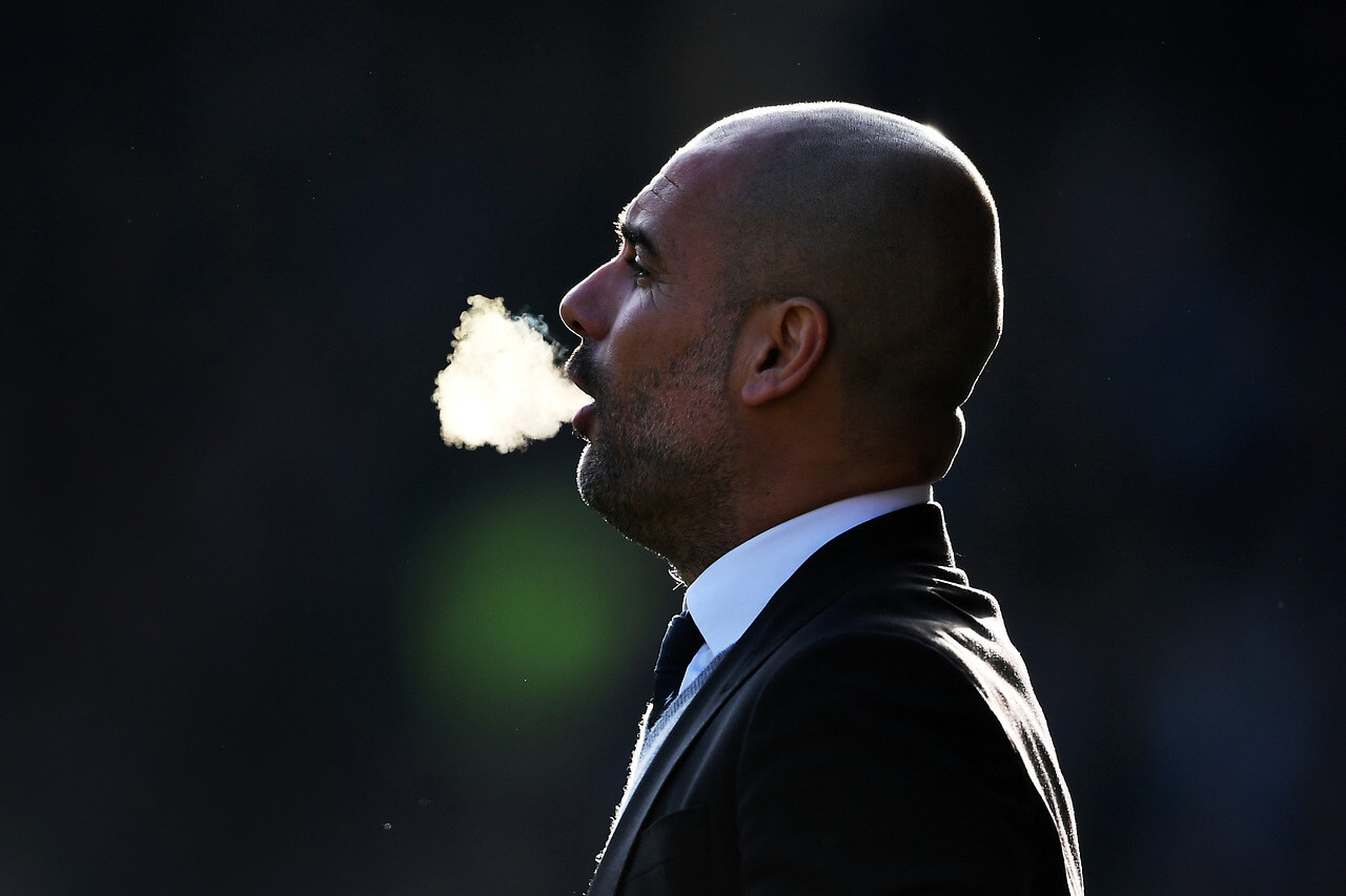 Manchester City coach Pep Guardiola observes his team in the English Premier League