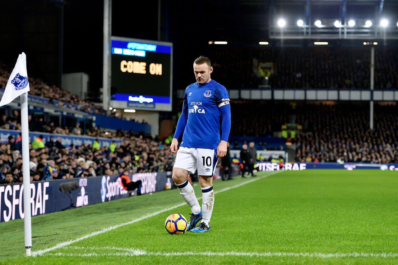 Everton player Wayne Rooney takes a corner kick in the English Premier League