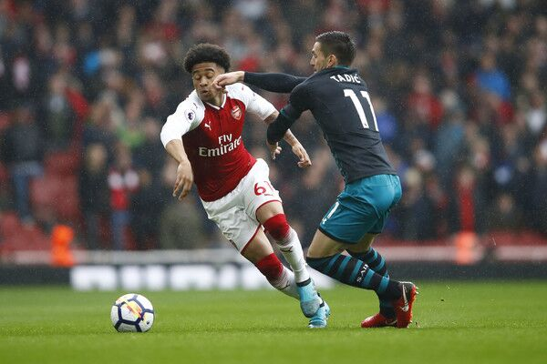 Arsenal winger Reiss Nelson dribbles effortlessly past Tadic in the English Premier League
