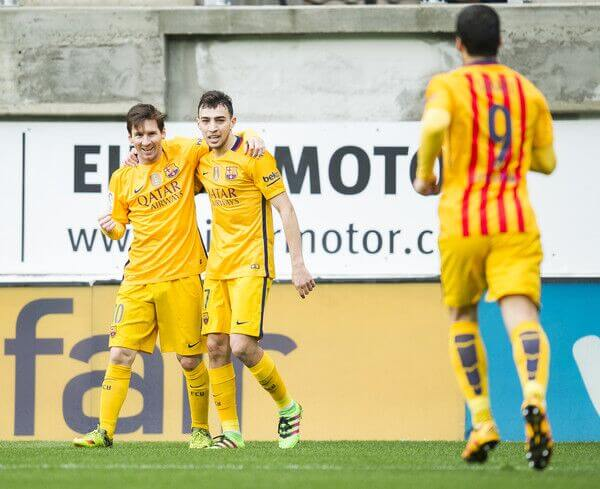 Barcelona forward Munir El Haddadi celebrates a goal with Lionel Messi in La Liga