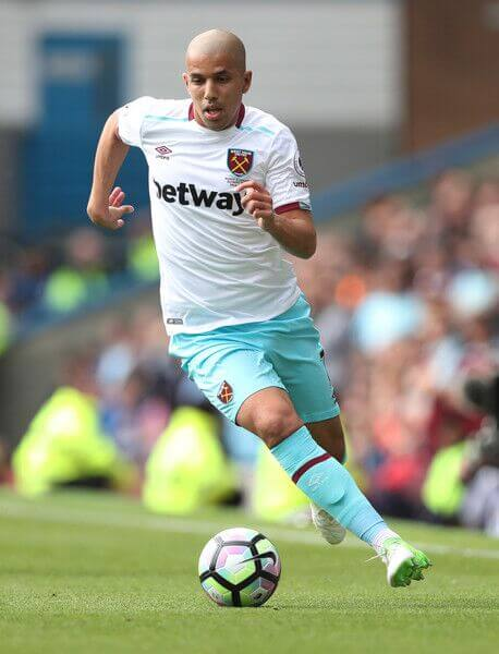 Feghouli dribbles the ball for West Ham in the English Premier League