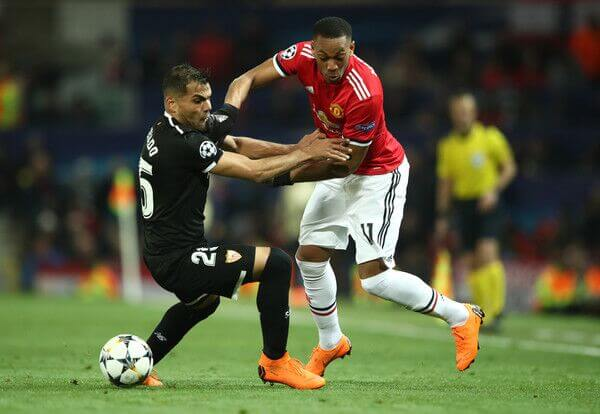 Manchester United winger Anthony Martial dribbles by Sevilla defender in UEFA Champions League