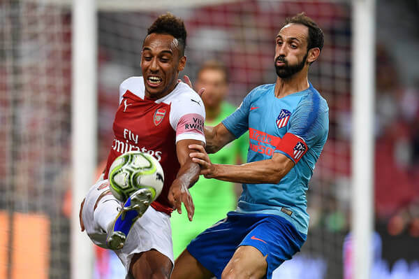 """Pierre-Emerick Aubameyang #14 of Arsenal and Juanfran #20 of Atletico Madrid completes for the ball during the International Champions Cup 2018 match between Club Atletico de Madrid and Arsenal at the National Stadium on July 26, 2018 in Singapore.""""  Thananuwat Srirasant/Getty Images AsiaPac  """""""