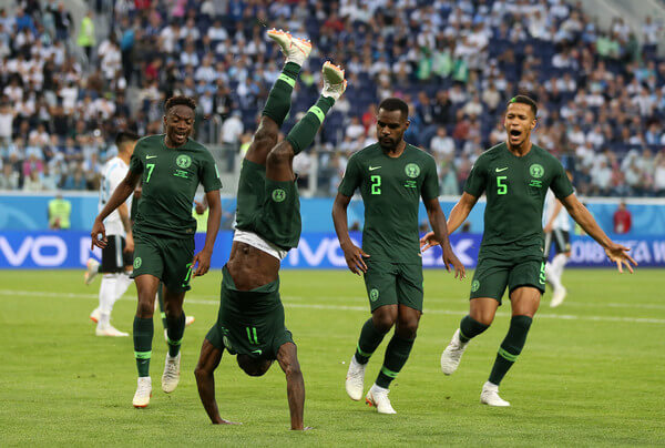 Victor Moses of Nigeria celebrates with teammates after scoring his team's first goal during the 2018 FIFA World Cup Russia group D match between Nigeria and Argentina at Saint Petersburg Stadium on June 26, 2018 in Saint Petersburg, Russia.  (June 25, 2018 - Source: Gabriel Rossi/Getty Images Europe)