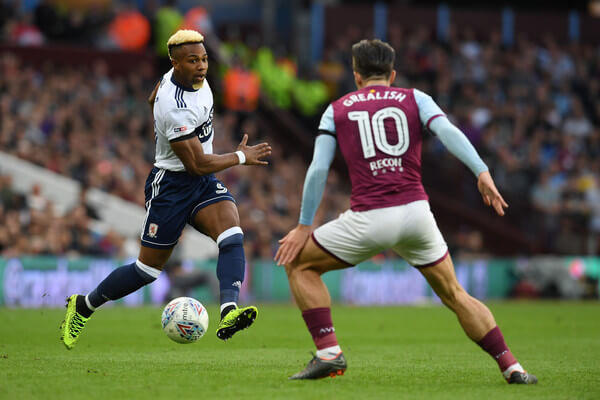 Adama Traore of Middlesbrough controls the ball as Jack Grealish of Aston Villa looks on during the Sky Bet Championship Play Off Semi Final second leg match between Aston Villa and Middlesbrough at Villa Park on May 15, 2018 in Birmingham, England.    (May 14, 2018 - Source: Ross Kinnaird/Getty Images Europe)