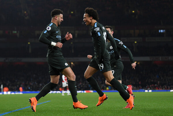 Leroy Sane of Manchester City celebrates the third goal with Kyle Walker during the Premier League match between Arsenal and Manchester City at Emirates Stadium on March 1, 2018 in London, England.    (Feb. 28, 2018 - Source: Shaun Botterill/Getty Images Europe)